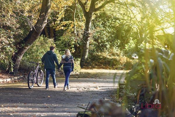 Couple walking with mountain bike