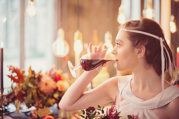 Bride sipping wine