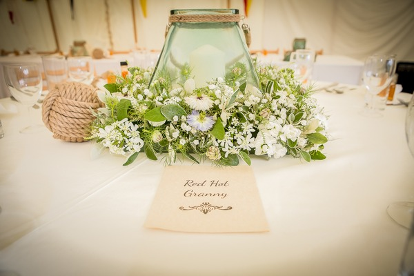 Vase and floral wedding table centrepiece
