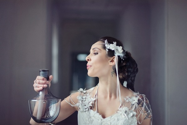 Bride blowing out candle