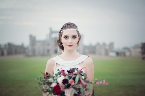 Bride holding bouquet in front of her