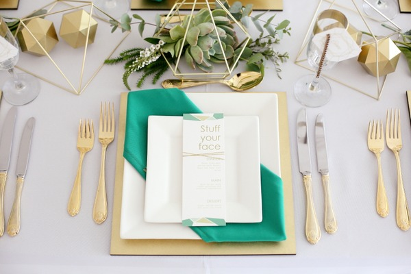 Wedding place setting with green and gold styling