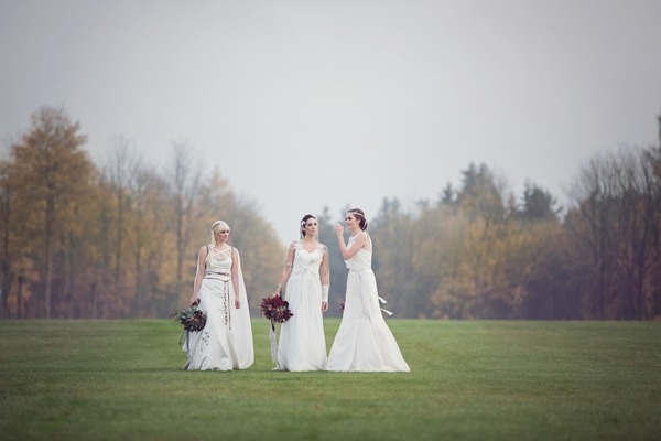 Brides walking in Lowther Castle grounds