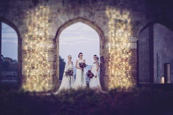 Brides standing in arch