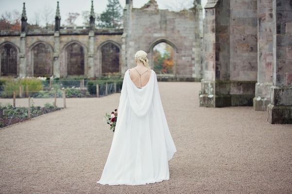 Back of bride with hooded cape