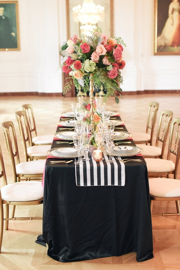 Wedding table with black tablecloth and striped runner