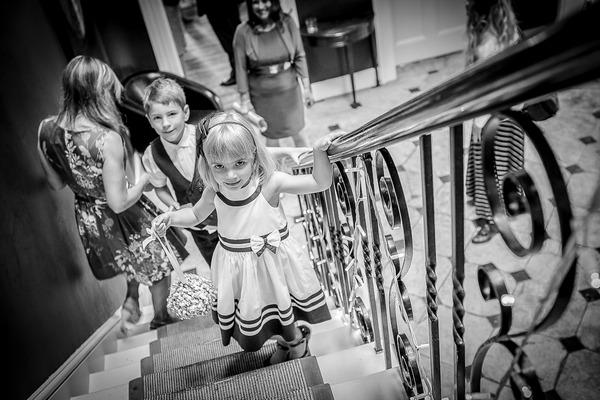Flower girl walking up stairs