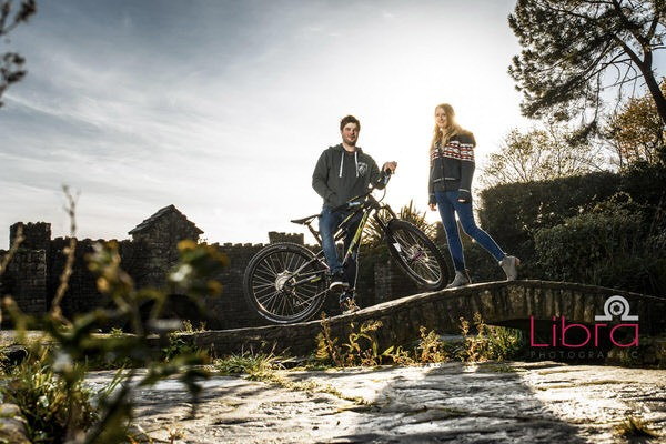 Man on mountain bike with his fiancée