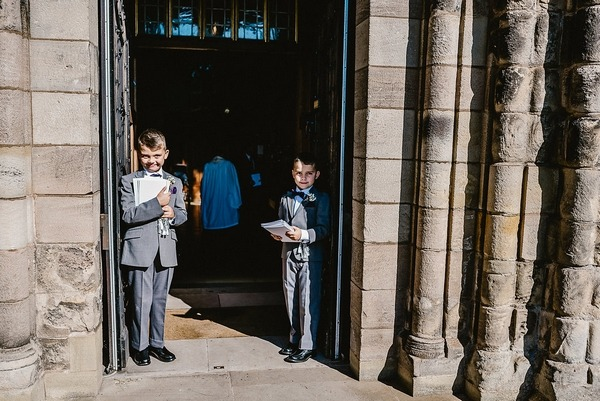Young ushers at church entrance