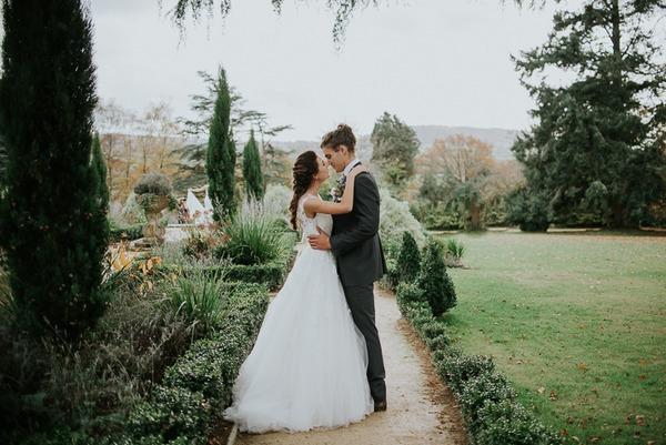 Bride and groom in garden of Deer Park