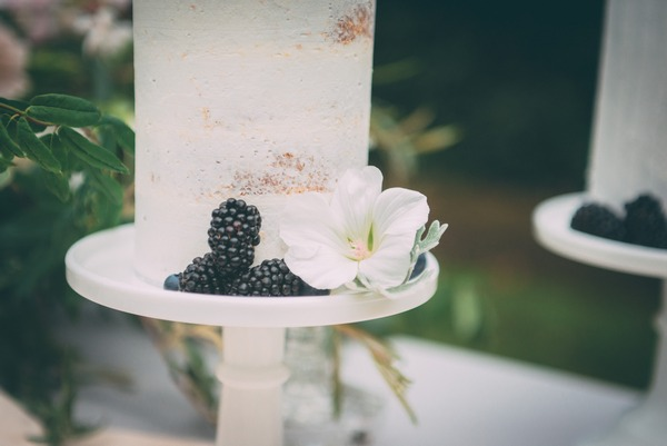 Blackberries and flower on wedding cake