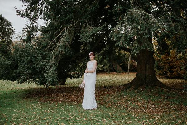Bride standing under tree