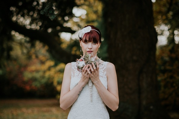 Bride holding bouquet under her chin