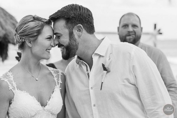 Man pulling funny face behind bride and groom - Picture by That Moment Photo