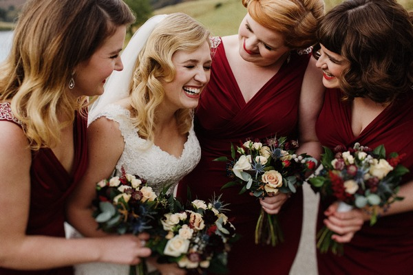 Bride laughing with bridesmaids - Picture by Jess Petrie Photography