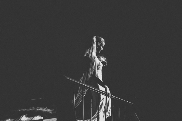 Black and white picture of bride walking down the stairs - Picture by Ayesha Photography
