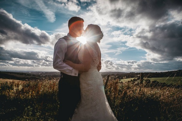 Sun shining between bride and groom - Picture by Claire Basiuk Photography