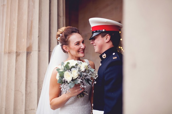 Bride and military groom smiling - Picture by Honeydew Moments
