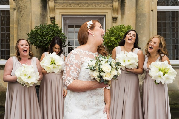 Bride laughing with her bridesmaids - Picture by Nick Church Photography
