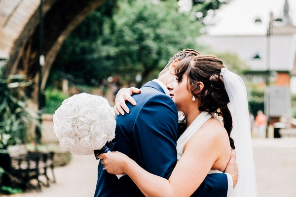 Emotional bride hugging groom - Picture by Jamiri Photography