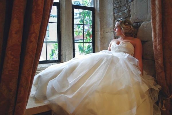 Bride sitting by window
