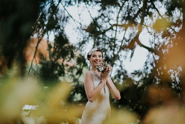 Bride seen through tree branches