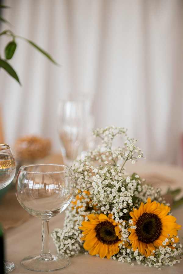 Sunflower and gypsophila bouquet on table