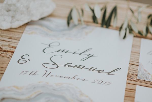 Grey writing on wedding invitation