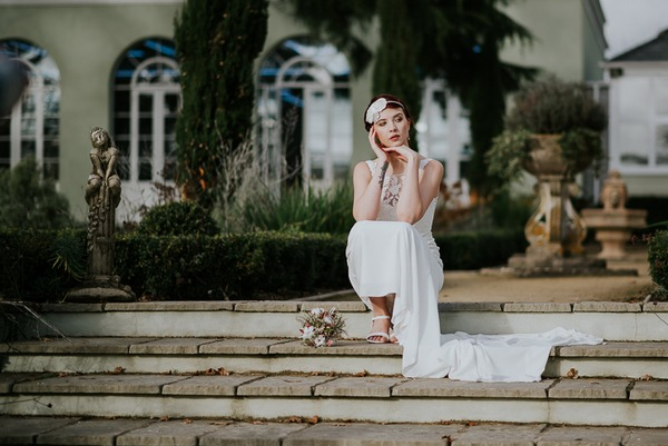 Bride sitting on steps of Deer Park