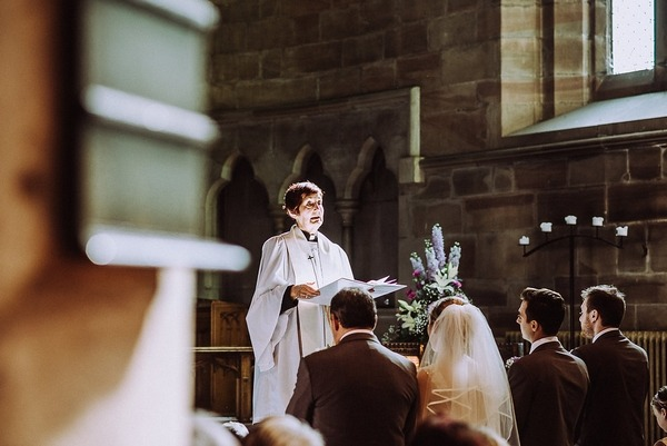 Vicar taking wedding ceremony