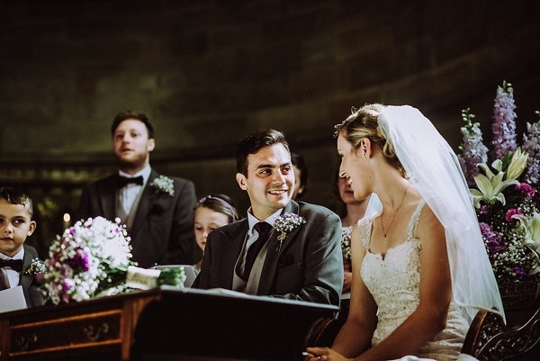 Bride and groom sitting in church