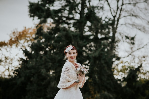 Bride wearing winter shrug
