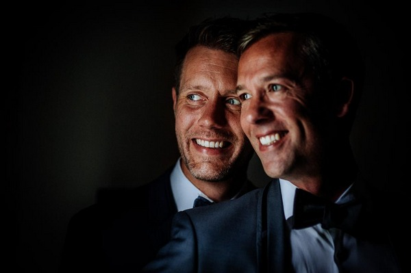 Grooms smiling together