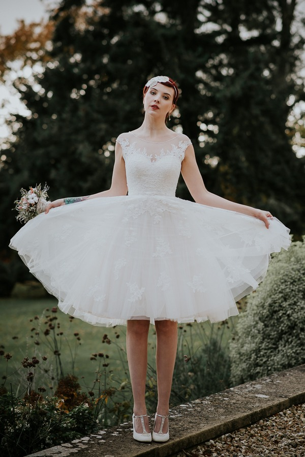 Bride holding out skirt on wedding dress