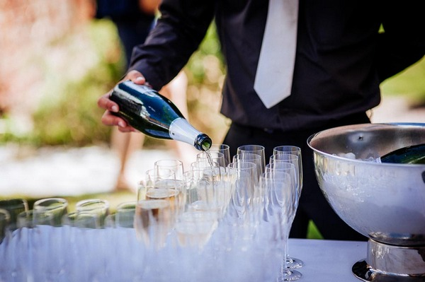 Pouring champagne at wedding