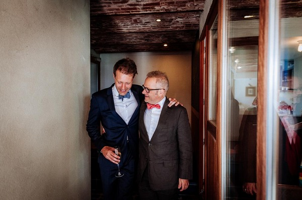 Groom welcoming wedding guest