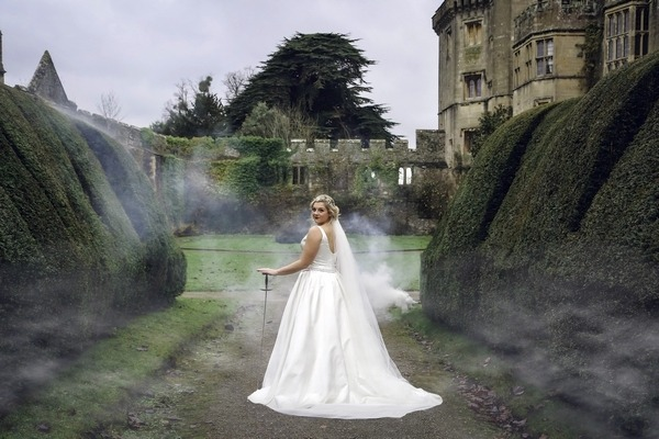Bride with sword in grounds of Thornbury Castle