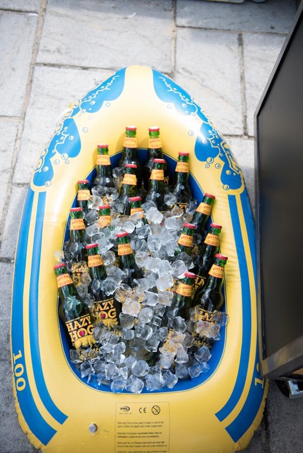 Drinks in dinghy at seaside wedding