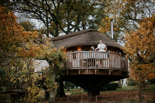 Bride on balcony of Deer Park tree house