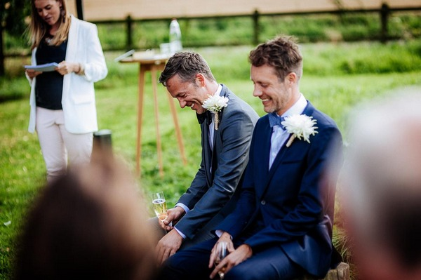 Grooms laughing during wedding ceremony