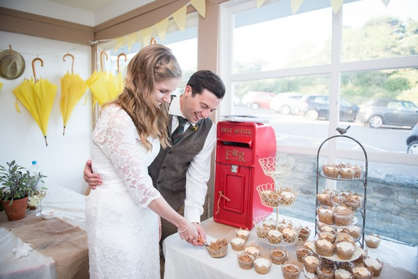 Bride and groom cutting cupcake