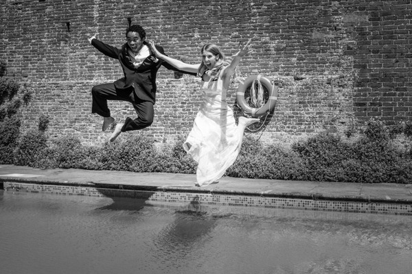 Couple jumping into pool - Picture by Libra Photographic