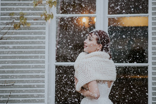 Bride in shrug in snow
