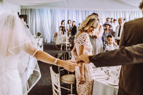 Bride and groom's outstretched hands