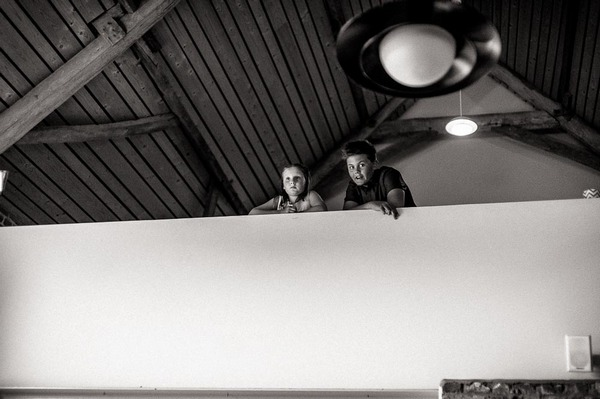 Boys looking over balcony at wedding