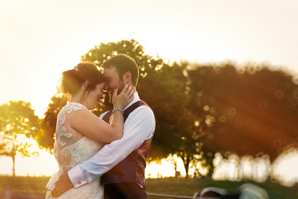 Bride and groom touching heads - Picture by Libra Photographic