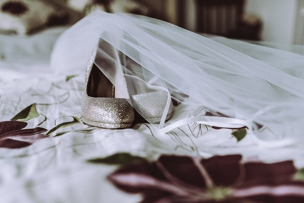 Shoes and veil on bed