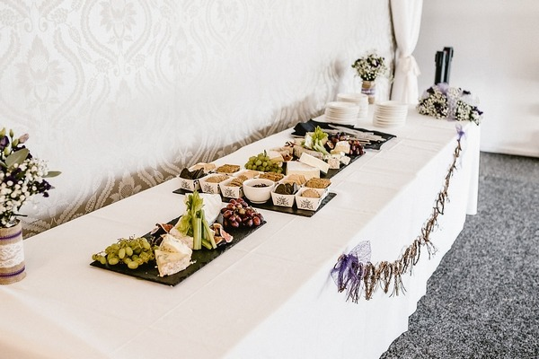 Long table at wedding with cheese and crackers