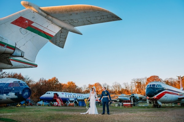 Bride and groom in airfield - Picture by Emma-Jane Photography