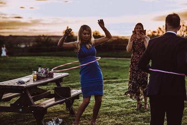 Wedding guest hula hooping